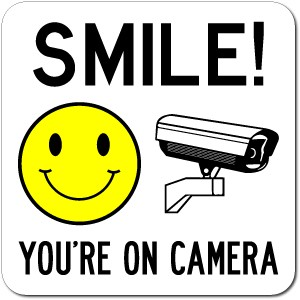 Nerdy image for smile you re on camera sign printable